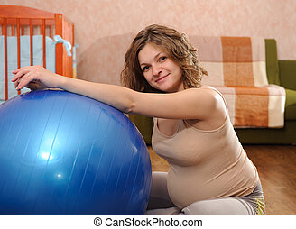 Pregnant woman with ball - Young pregnant woman with blue...