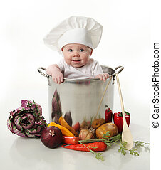 Baby in a cooking pot - Portrait of a smiling baby sitting...