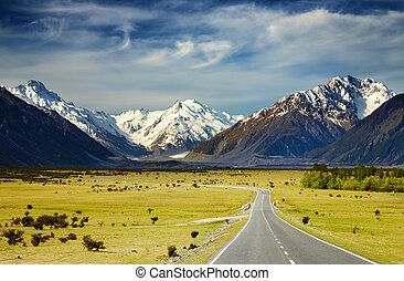 Southern Alps, New Zealand - Landscape with road and snowy...