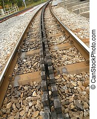 rails - close up of the rails of a trainline that climbs...