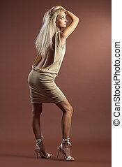 Beautiful girl - Beautiful sexual high-heeled girl on brown...