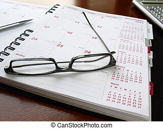 Monthly planner with glasses - Monthly planner with reading...