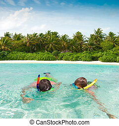 Children snorkeling in tropics