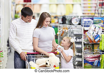 Happy family in the store