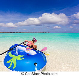 Girl in ocean - Girl on inflatable dingy in ocean