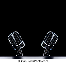 Retro Mic - two Retro Mic's stage background in black with...
