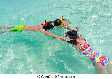 Children snorkeling in sea
