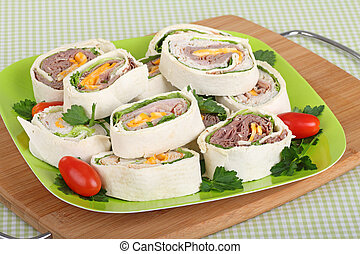 Tortilla Meat Wraps - Meat and cheese wrapped in tortilla on...
