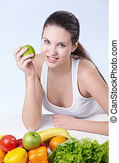 Vegetarianism - Attractive girl with fruits and vegetables...