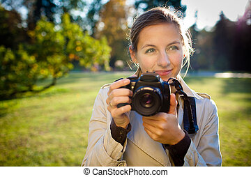 pretty female photographer outdoors on a lovely day