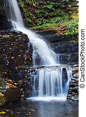 Autumn Waterfall in mountain from Bushkill Falls,...