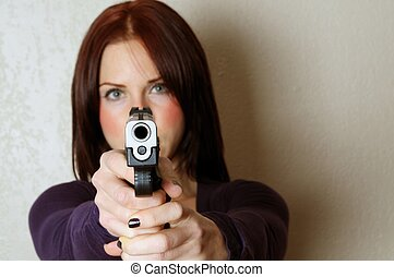 Breaking and Entering - Image of female pointing a gun at...