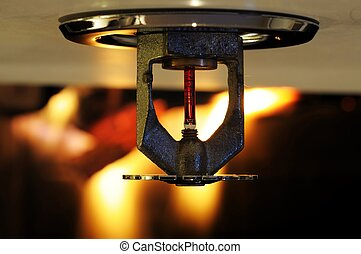 Fire Sprinkler - Close up image of fire sprinkler with fire...