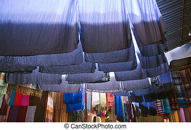 Dyed cloth hanging up to dry