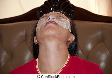 facial mask 3 - Chinese woman with a facial mask