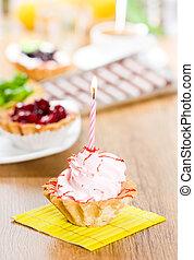 Pink birthday cupcake