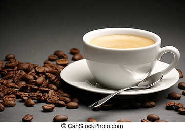Cup of coffee and coffee beans - White cup of coffee with...