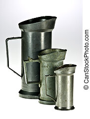 Measuring vessels - Old tin measuring vessels on white...