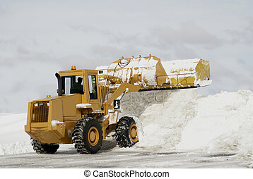 Large Yellow Snow Plow 3 - A large yellow snow plow dumping...