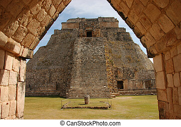 Uxmal Pyramid - view of Uxmal pyramid through arch