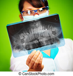 Doctor with xray - female doctor with jaw xray focus on xray...