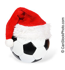 Santa Claus hat on the soccer ball on the white background...