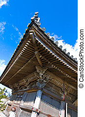 Side view on a teahouse in Japan under blue sky