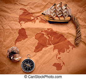 compass, shell and model classic boat on old paper -...
