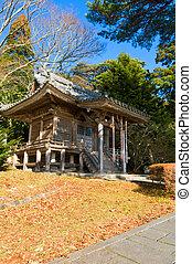Zen building in a garden at a sunny morning