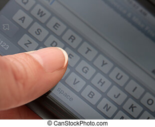Texting - Close-up of thumb or finger text messaging