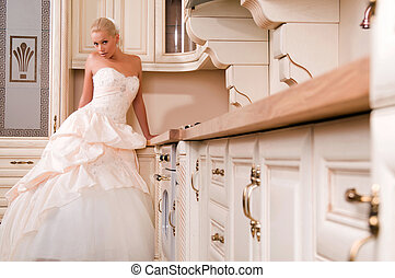 bride stands in the kitchen and laughs - beautiful bride...
