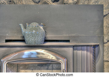 fireplace with a kettle