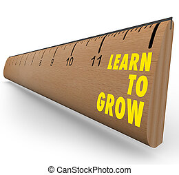 Ruler - Learn to Grow - A wooden ruler with the words Learn...