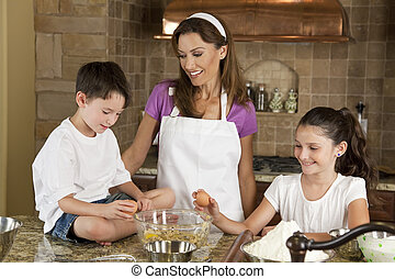 Mother, Son and Daughter Family In Kitchen Cooking Baking -...