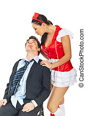 Seductive nurse with kissed businessman