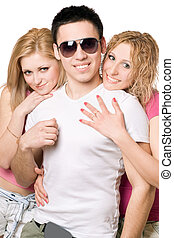 Portrait of a two cheerful blonde women with young man -...