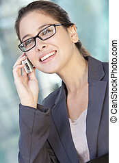 Smart Woman Businesswoman in Suit and Talking on Cell Phone