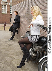 standing apart - pretty blond girl and her boyfriend...