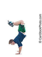 Young bboy standing on hands. Holding legs in air. Isolated...