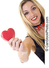 woman holding a big red heart and smiling