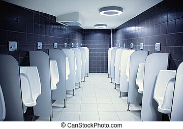 urinals - group of white porcelain urinals in public toilets...