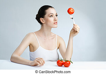eating healthy food - A beautiful slender girl eating...