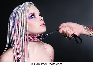 Slave - Young beautiful woman with dreads and collar playing...