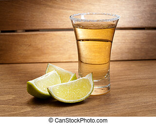 A shot of tequila - A shot of teqila in a shot glass with a...