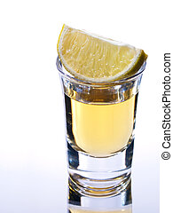 Tequila in a shot glass with lime