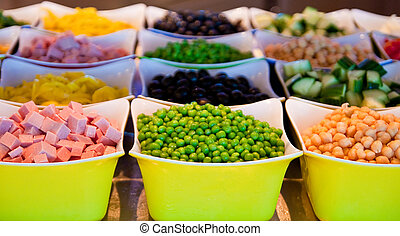 Green Peas and Vegetables on Fresh Salad Bar - Fresh green...