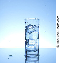 Refreshing drink - Glass of water with four ice cubes
