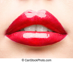 red lips closeup - close up studio shot of red glossy lips