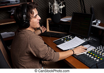 Radio DJ 2 - Radio DJ. Young man with microphone and...