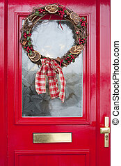 christmas wreath on red door - christmas wreath with...